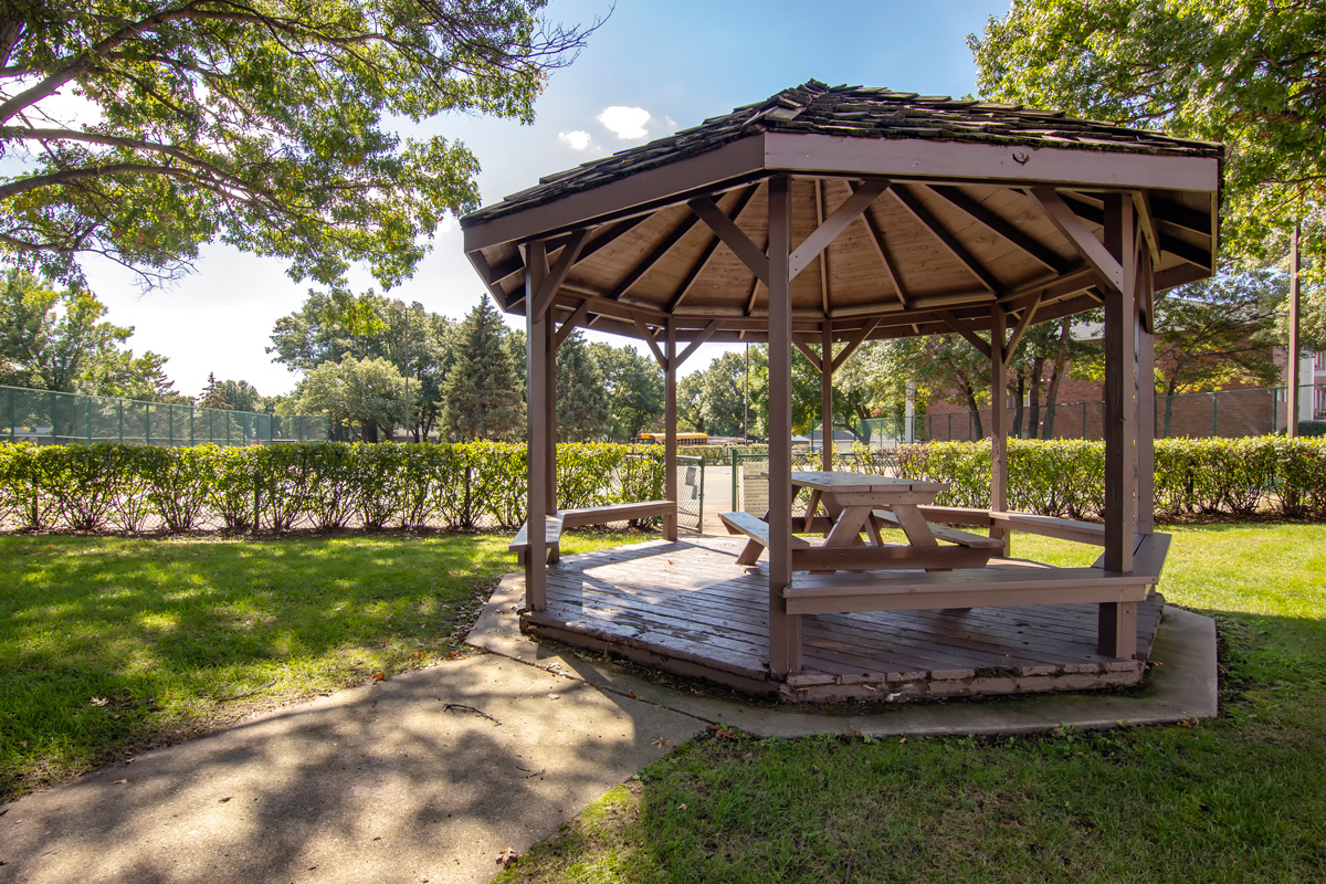 Outdoor gazebo with patio bench