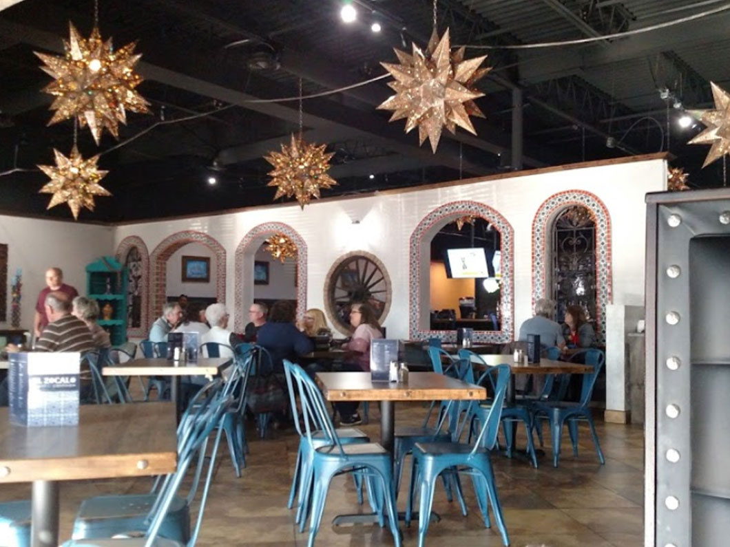 Indoor Mexican restaurant with star lights and tables with blue chairs