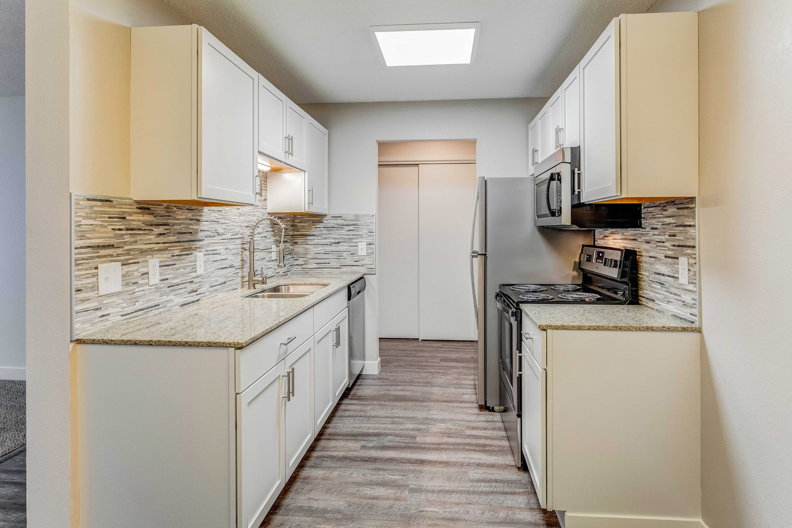 White galley kitchen at Carriage Oaks apartments.