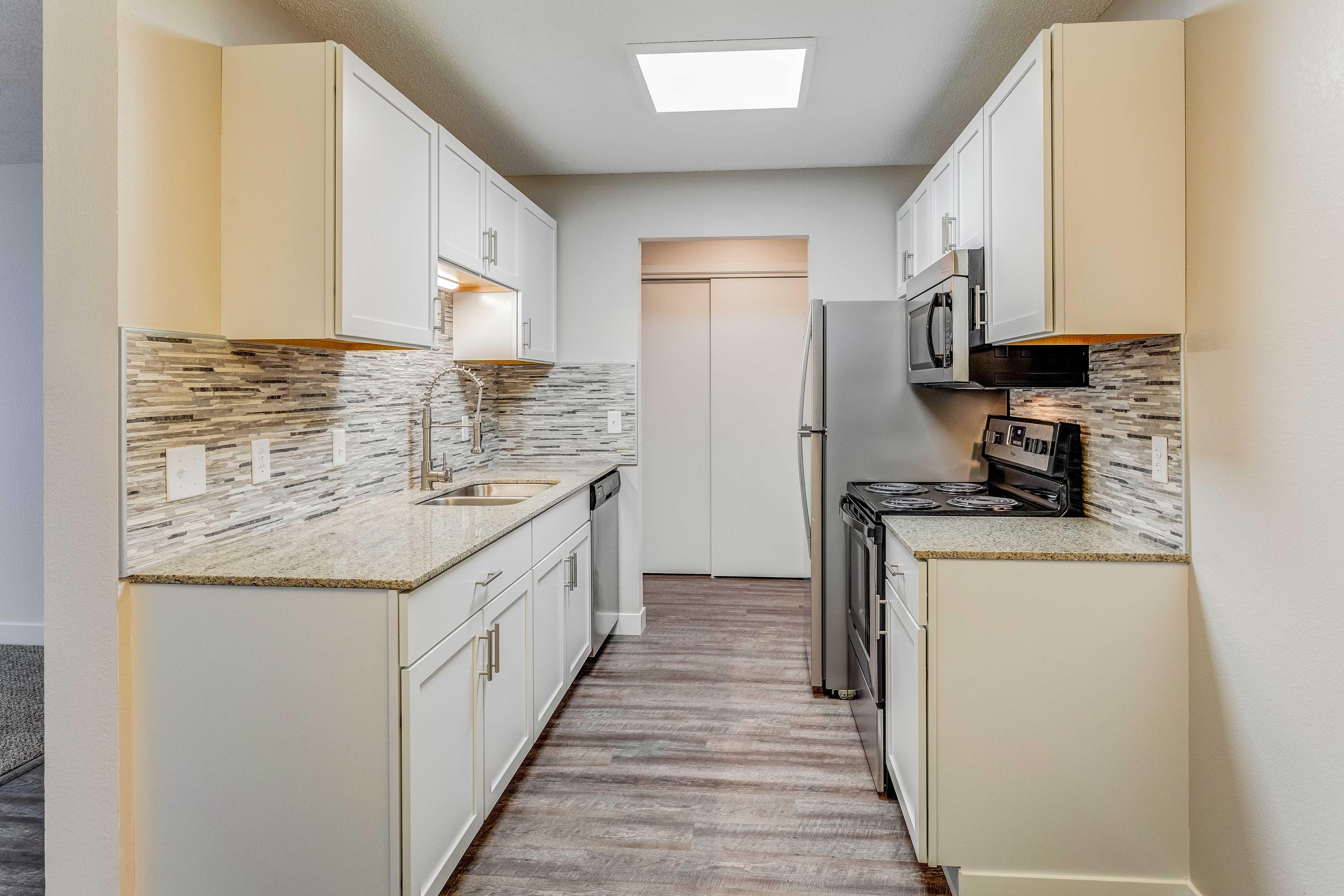 Galley kitchen view.